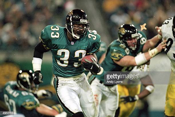 James Stewart of the Jacksonville Jaguars carries the ball during the game against the Pittsburgh Steelers at the Alltell Stadium in Jacksonville...