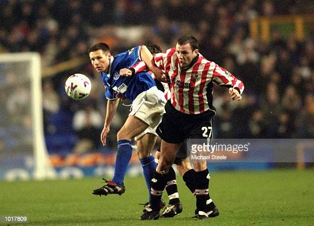 Jamie Robinson of Exeter battles with Nick Barmby of Everton during the FA Cup third round replay at Goodison Park in Liverpool England Everton won...