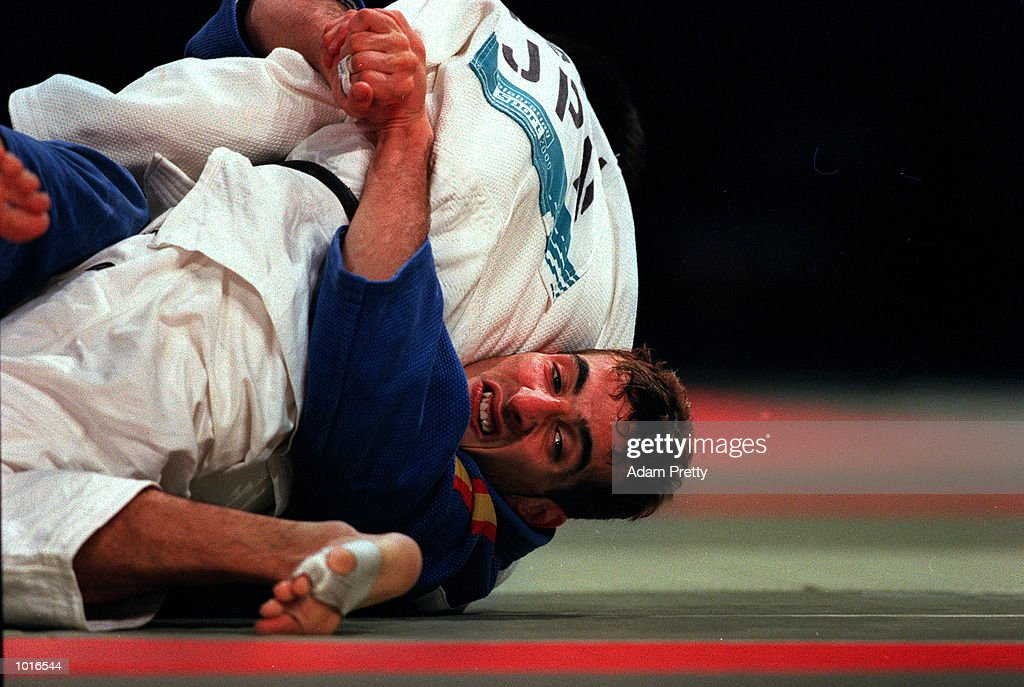 Javier Delgado of Spain who won the Gold medal fights Masatoshi Sasaki of Japan who the Bronze medal in the Mens 66 kilogram class of the Sydney Challenge Judo at Darling Harbour, Sydney, Australia. This is a SOCOG Test Event. Mandatory Credit: Adam Pretty/ALLSPORT