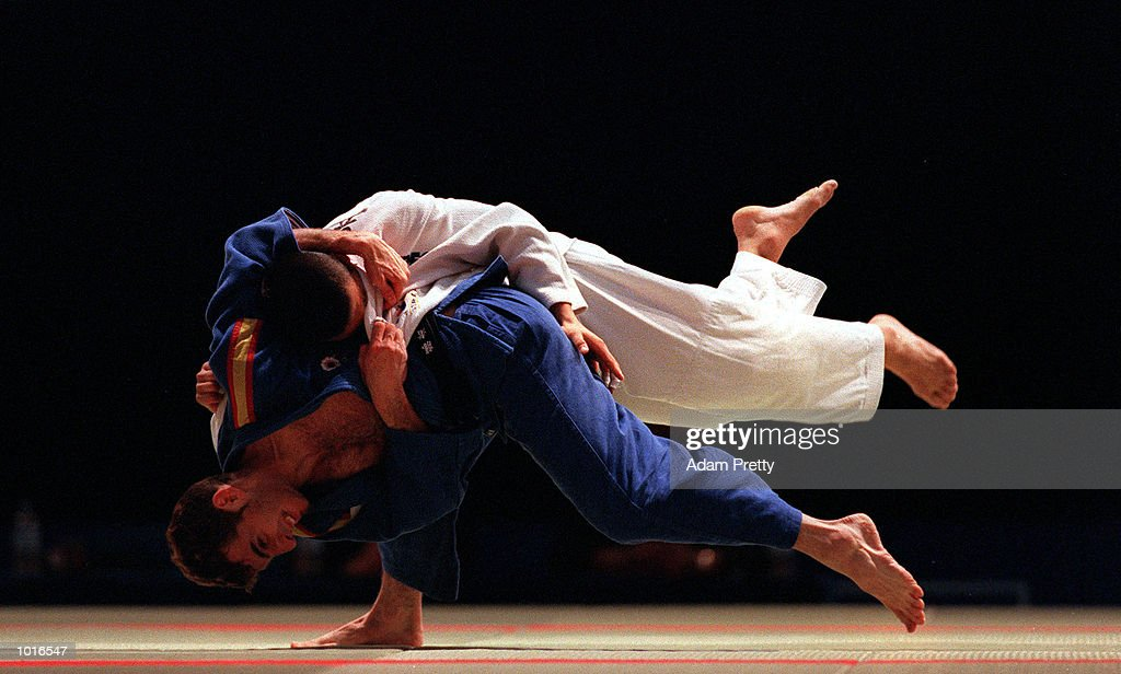 Javier Delgado of Spain who won the Gold medal throws Kyung-Sik Yoon of Korea who won the Silver medal during the Mens 66 kilogram class of the Sydney Challenge Judo at Darling Harbour, Sydney, Australia. This is a SOCOG Test Event. Mandatory Credit: Adam Pretty/ALLSPORT