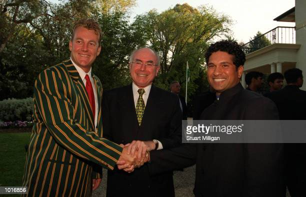John Howard Prime Minister of Australia with his Captain Shane Lee and Sachin Tendulkar Captain of India at the Prime Ministers Lodge in Canberra in...