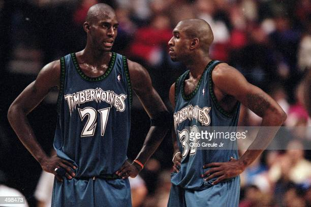 Kevin Garnett of the Minnesota Timberwolves talks to Joe Smith during a game against the Portland Trailblazers at the Rose Garden in Portland Oregon...