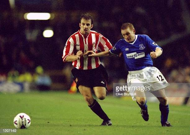 Kevin Kilbane of Sunderland and Mark Pembridge of Everton battle it out during the FA Carling Premiership match at Goodison Park in Liverpool England...
