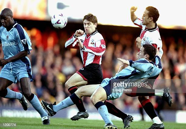Marian Pahars of Southampton is challenged by Paul Telfer of Coventry City with team mate Hassan Kachloul in support during the FA Carling...