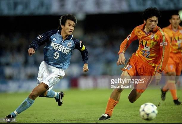 Masashi Nakayama of Jubilo Iwata goes past Junji Nishizawa of Shimizu S-Pulse during the Japanese J-League Suntory Championship First Leg match...