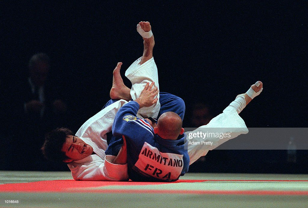 Masatoshi Sasaki of Japan on left who won the Bronze medal fights Manuel Armitano of France in the Mens 66 kilogram class of the Sydney Challenge Judo at Darling Harbour, Sydney, Australia. This is a SOCOG Test Event. Mandatory Credit: AdamPretty/ALLSPORT