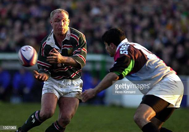 Neil Back of Leicester gets his pass away before the tackle of Nick Greenstock of Harlequins during the Leicester Tigers v Harlequins Rugby Union...