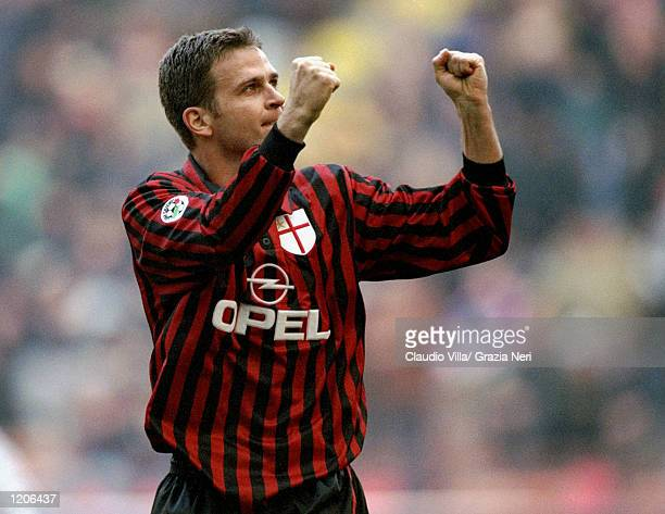 Oliver Bierhoff of AC Milan salutes his goal during the Italian Serie A match against Torino played at the San Siro in Milan Italy The game finished...