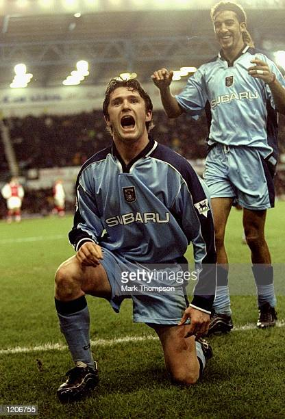 Robbie Keane of Coventry City celebrates his 71st minute goal during the FA Carling Premier League match against Arsenal played at Highfield Road in...