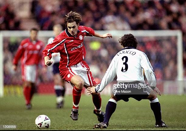 Robbie Stockdale of Middlesbrough goes past Mauricio Taricco of Tottenham Hotspur during the FA Carling Premiership match at the Riverside Stadium in...