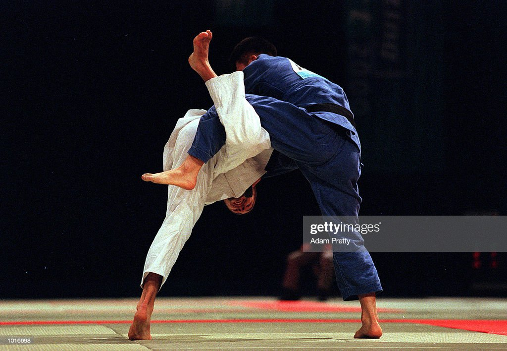 Sung-Ho Min of Korea on his way to the gold medal with this powerful move against Christophie Massina of France during the Mens 73 kilogram class of the Sydney Challenge Judo at Darling Harbour, Sydney, Australia. This is a SOCOG Test Event.Mandatory Credit: Adam Pretty/ALLSPORT
