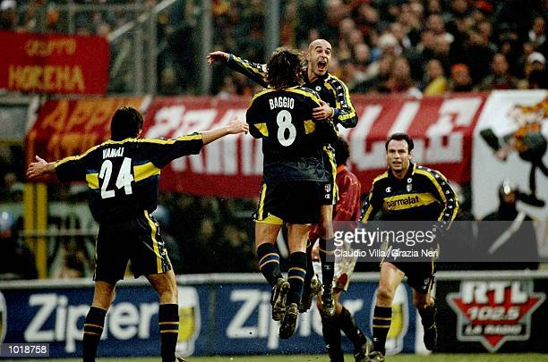 The Parma team celebrate Torrisi's goal during the Italian Serie A match against Roma played at the Stadio Tardini in Turin Italy Parma won the game...
