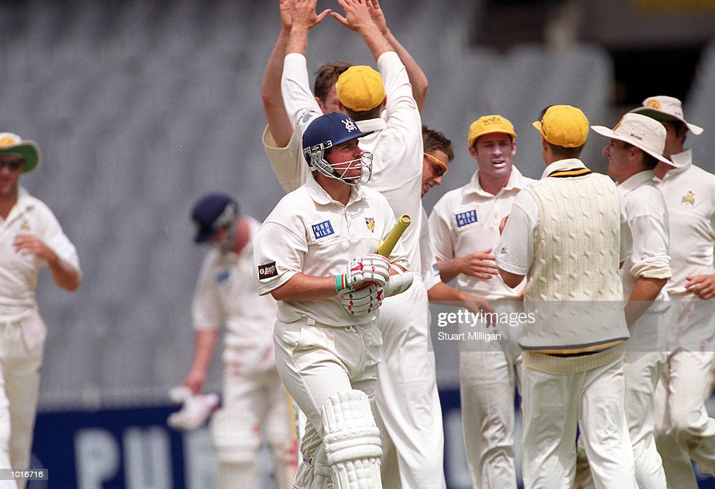 Victorian opening batsman Jason Arnberger departs after being adjudged lbw to Sean Carey during Victorias second innings, of the Pura Milk Cup match, being played at the MCG, Melbourne, Australia, with Victoria gaining first innings points.Mandatory Credit: Stuart Milligan/ALLSPORT
