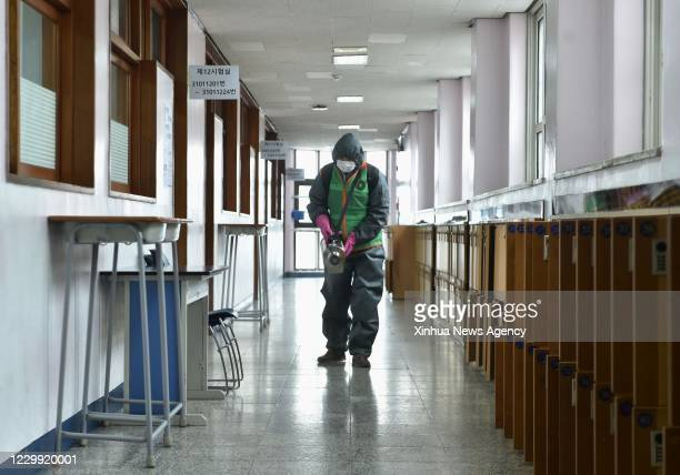 Dec. 2, 2020 -- A staff member sterilizes facilities at a high school to be used as exam site for the College Scholastic Ability Test CSAT in...