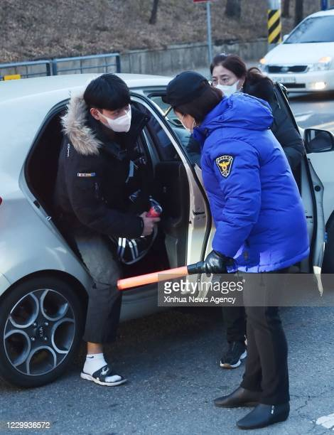 Dec. 2, 2020-- An examinee arrives at the test site for the College Scholastic Ability Test CSAT in Seongnam City of Gyeonggi Province, South Korea,...