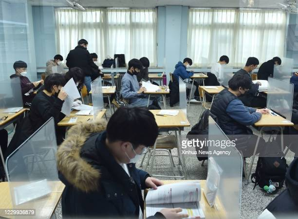 Dec. 2, 2020-- Examinees are seen before the College Scholastic Ability Test CSAT in Seongnam City of Gyeonggi Province, South Korea, Dec. 3, 2020....
