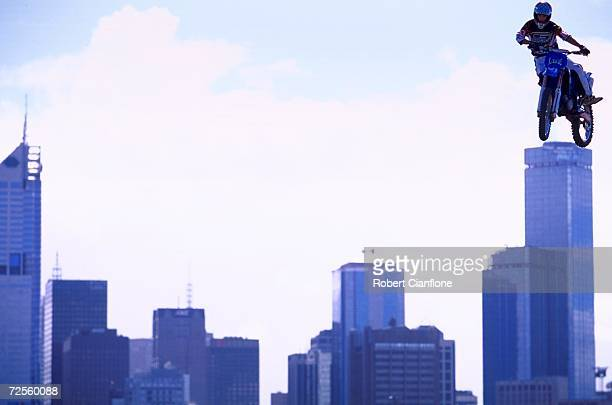 A competitor in the Freestyle MotoCross gets some air with the city of Melbourne in the background during the mornings practice session for the...