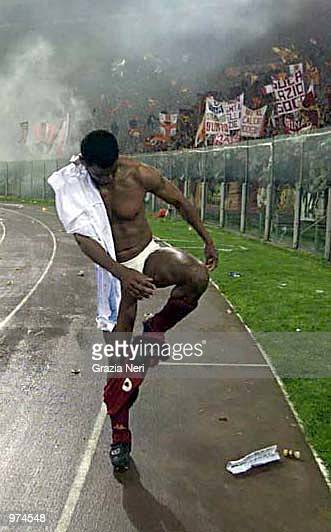 Aldair of Roma throws his kit into the crowd after victory in the Lazio v Roma league match at the Olympic Stadium Rome Italy Digital Image Mandatory...