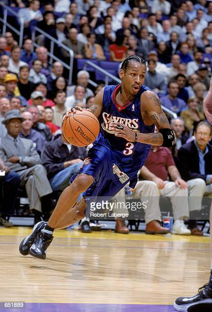 Allen Iverson of the Philadelphia 76ers dribbles the ball to the basket during the game against the Los Angeles Lakers at the STAPLES Center in Los...