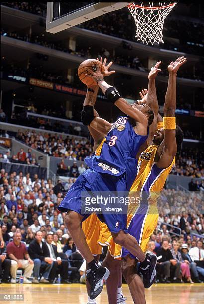 Allen Iverson of the Philadelphia 76ers leaps for the basket as he is blocked by Kobe Bryant of the Los Angeles Lakers at the STAPLES Center in Los...
