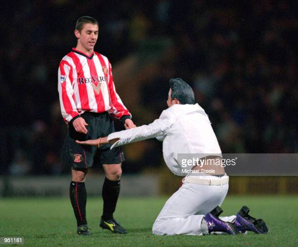 An Elvis Impersonator worships at the feet of Kevin Phillips of Sunderland during the FA Carling Premiership game against Bradford City at Valley...