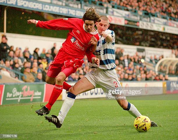 Ben Olsen of Nottingham Forest challenges Ian Barraclough of Queens Park Rangers during the Nationwide Division One game at Loftus Road in London...