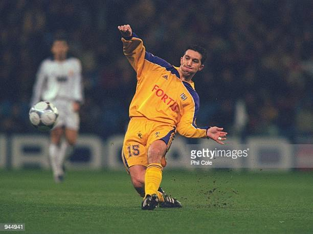 Besnik Hasi of Anderlecht passes the ball during the UEFA Champions League Group D match against Real Madrid played at the Bernabeau in Madrid Spain...