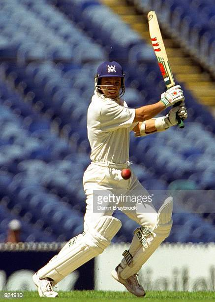 Brad Hodge plays the ball square of the wicket, during the game between the Victoria Bushrangers and the Tasmania Tigers played at the MCG in...