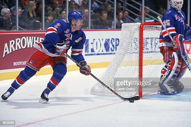 Brian Leetch of the New York Rangers moves with the puck around the net during the game against the Anaheim Mighty Ducks at the Arrowhead Pond in...