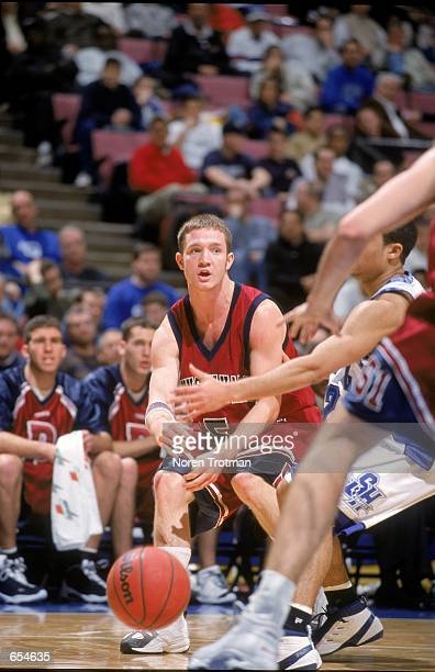 Charlie Copp of the Pennsylvania Quakers bounce passes the ball during the game against the Seton Hall Pirates at the Continental Airlines Arena in...