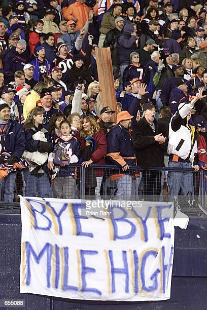 Cheering fans say goodbye to Mile High stadium after the Denver Broncos defeated the San Francisco 49ers 38-9 at Mile High Stadium in Denver,...