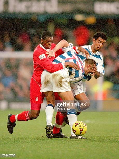 Chris Plummer and Richard Langley of Queens Park Rangers challenge Marlon Harewood of Nottingham Forest during the Nationwide Division One game at...