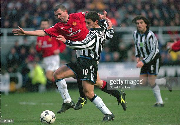 Christian Bassedas of Newcastle United holds off Roy Keane of Manchester United during the FA Carling Premiership match played at St James Park in...