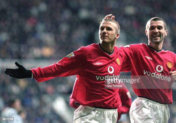 David Beckham and Roy Keane of Manchester United celebrate during the FA Carling Premiership match against Newcastle United played at St James Park...