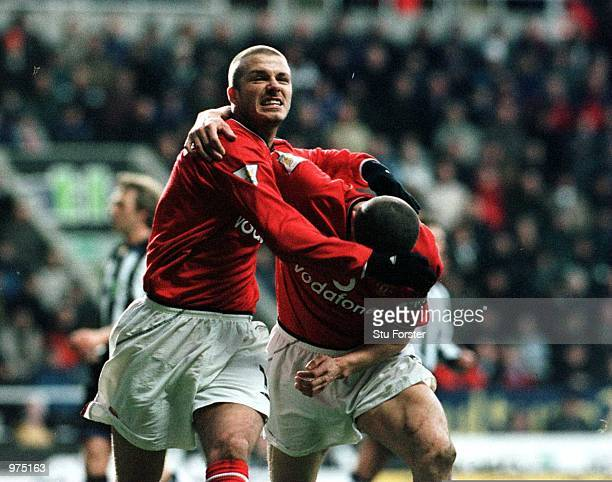 David Beckham of Man Utd celebrates with Roy Keane after scoring the first goal during the Newcastle United v Manchester United FA Carling...