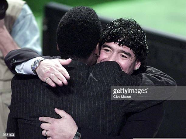 Diego Maradonna of Argentina tries to make up with Pele of Brazil afetr their recent disagreement at the FIFA World Player Gala at the Auditorium del...