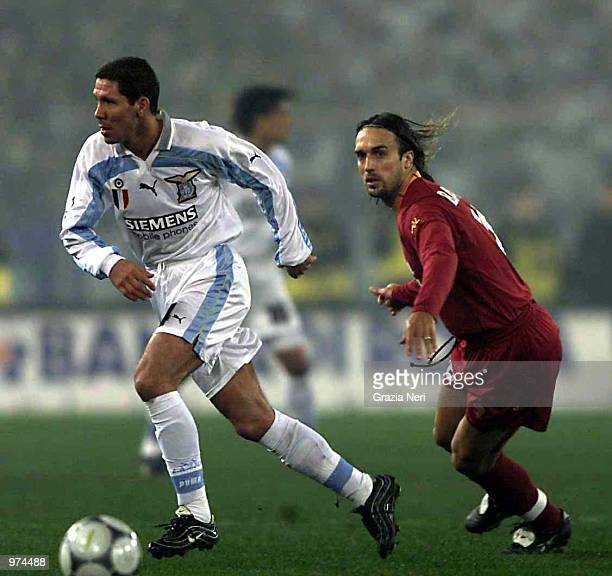 Diego Pablo Simeone of Lazio and Gabriel Omar Batistuta of Roma in action during the Lazio v Roma league match at the Olympic Stadium Rome Italy...