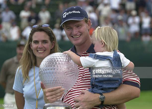 Ernie Els of South Africaholding the trophy with his wife Liezl and his daughter Samantha after his playoff victory against Lee Westwood during the...