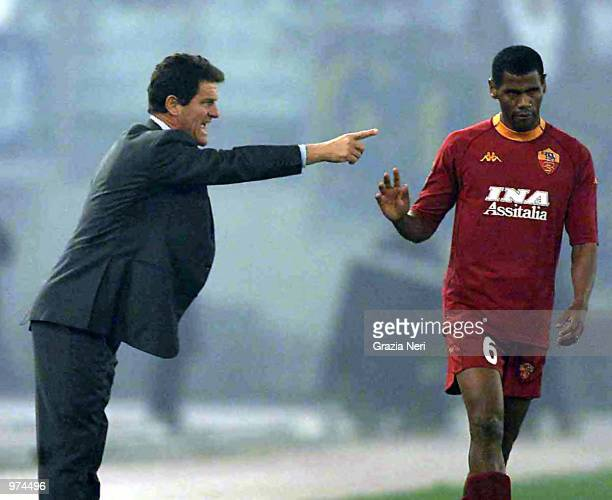 Fabio Capello coach of Roma speaks with Aldair during the Lazio v Roma league match at the Olympic Stadium Rome Italy Digital Image Mandatory Credit...