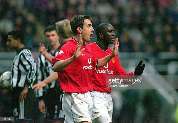 Gary Neville and Dwight Yorke of Manchester United appeal during the FA Carling Premiership match against Newcastle United played at St James Park in...