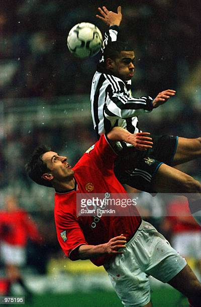 Gary Neville of Man Utd clashes with Kieron Dyer of Newcastle during the Newcastle United v Manchester United FA Carling Premiership match at St...