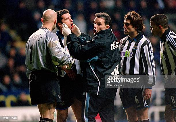 Gary Speed of Newcastle United receives treatment on the pitch during the FA Carling Premiership match against Manchester United played at St James...