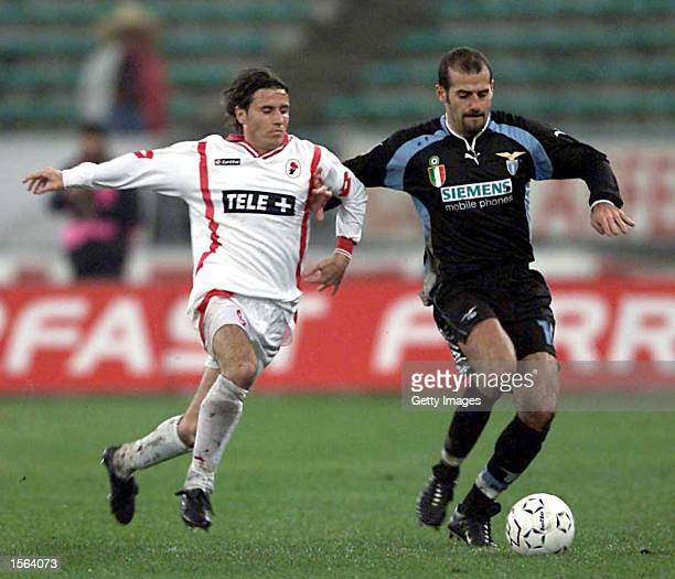 Giuseppe Pancaro of Lazio and Yksel Osmanowski of Bari challenge for the ball during the Serie A 12th Round League match between Bari and Lazio...