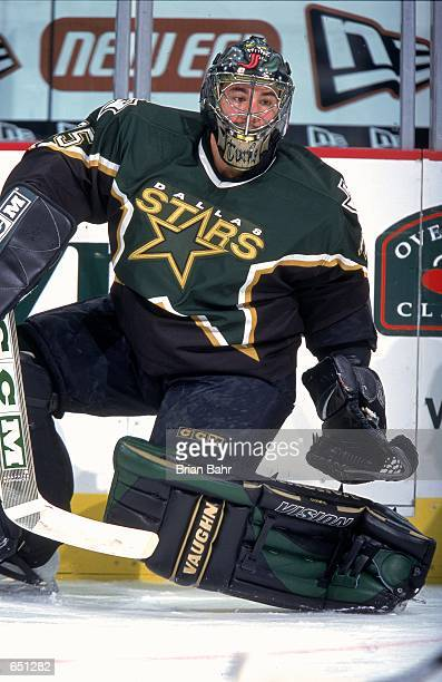 Goaltender Marty Turco of the Dallas Stars moves to block the puck during the game against the Colorado Avalanche at the Pepsi Center in Denver,...
