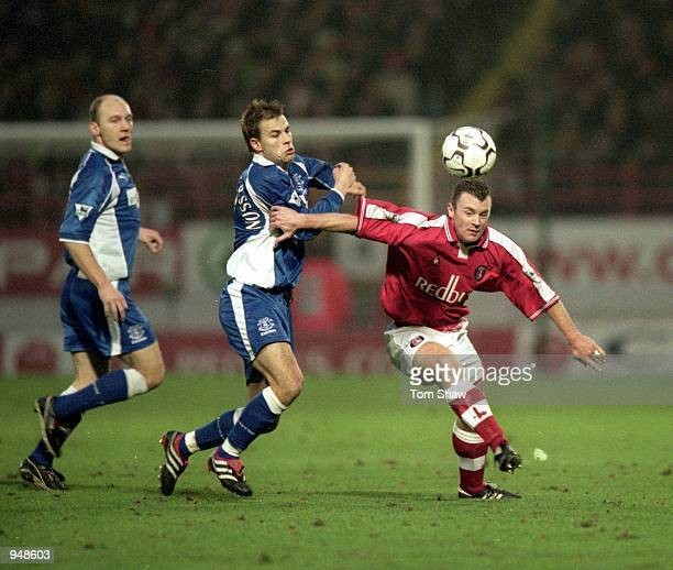 Graham Stuart of Charlton Athletic holds off Niclas Alexandersson of Everton during the FA Carling Premiership match played at The Valley in London...