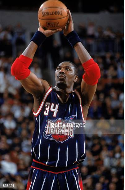 Hakeem Olajuwon of the Houston Rockets gets ready to shoot a free throw during the game against the Seattle SuperSonics at Key Arena in Seattle,...