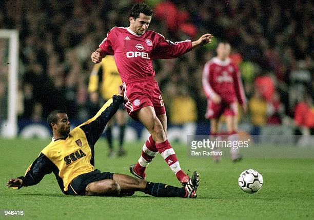 Hasan Salihamidzic of Bayern Munich evades Ashley Cole of Arsenal during the UEFA Champions League Group C match played at Highbury in London The...