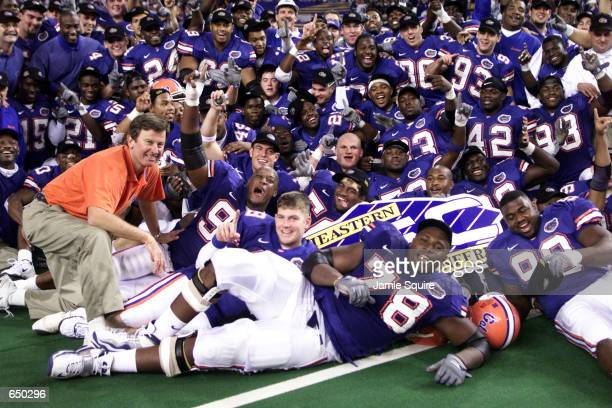 Head coach Steve Spurrier of the Florida Gators poses with players following the Gators'' 28-6 victory over Auburn to win the Southeastern Conference...