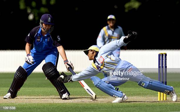Indian wicketkeeper Anju Jain dives to take the ball as Jane Cassar of England looks on during the England v India match in the 2000 CricInfo Womens...