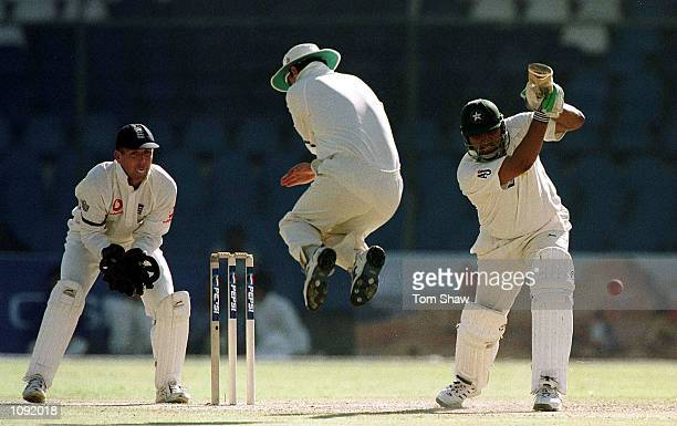 Inzamam Ul Haq of Pakistan hits out as Graham Thorpe of England jumps out of the way during the 3rd Pakistan v England Test match at the National...